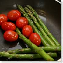 Vegetables being fried in a saucepan